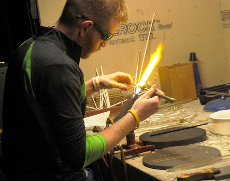 Neil Messinger, fourth-year Ohio State student in glass blowing and strategic communication, works with a glass-blowing torch at glass studio N8 Glass. March 1, 2015; Columbus, Ohio