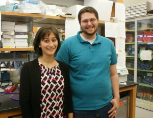 Students at The Ohio State University College of Veterinary Medicine Marisa Maglaty (left) and Alexander Diedrich (right), pose in their lab at the Biomedical Research Tower in July 2015.