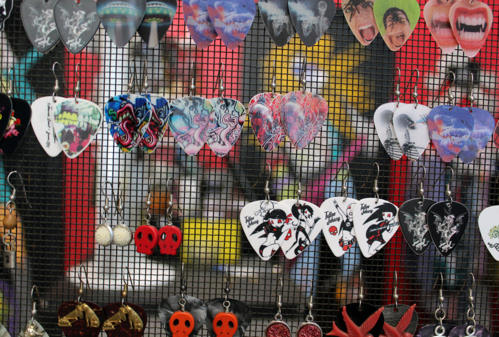 "Handcrafted guitar-pick earrings are just one of the unique gift items shoppers can find at Columbus, Ohio-based What The Rock?! Other fun products include onesies for babies with catchy phrases as well as ""rock and rollsaries,"" rosaries featuring pictures of iconic musicians."